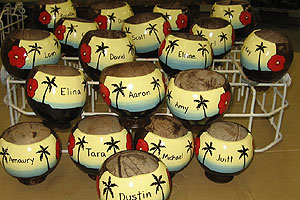 Hand painted coconut drinking cups used as commemorative gifts for the bridal party