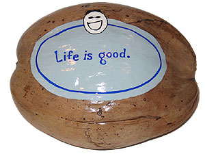 The Life is Good logo painted on a coconut for an unusual advertising specialty marketing promotion
