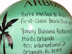 Fresh marketing ideas. Hand painted corporate invitation on half shell coconuts