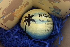 Painted coconuts make incentive trip invitations