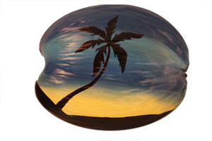 hand painted sunset scene on a coconut