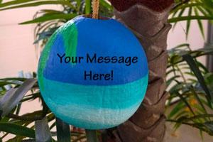 painted coconut ornaments and holiday decor