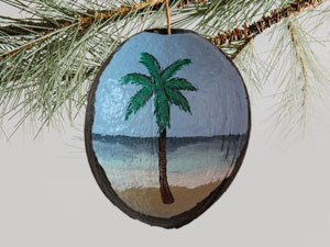 coconut painted coastal ornament with beach and palm tree