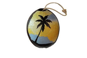 painted coconut ornament with sunset and palm tree
