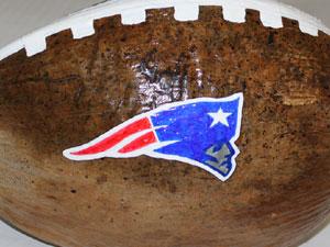 Patriots football painted coconut